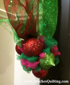 Tulle Grinch Ball at end of mantel. Here are more details of how we decorated the Glammed out Grinch Fireplace Mantle.
